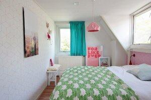 Double bed in retro attic bedroom
