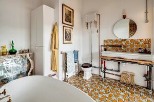 Ornate floor tiles in eclectic, retro bathroom