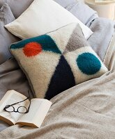 A homemade knitted cushion made from felted wool