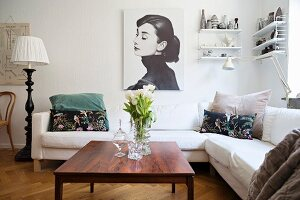 White sofa and vintage furniture in living room
