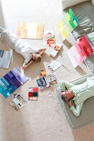 Couple looking at colour samples on floor