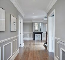 Elegant hallway with mouldings on walls and panelled doors