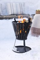 Fire basket amongst snow for winter picnic
