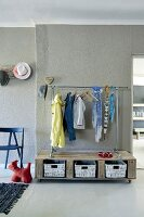 DIY coat rack made from reclaimed wood and metal piping