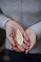 Gold leaf-shaped pendant