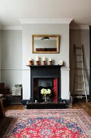 Open fireplace with cast iron surround in chimney breast flanked by niches