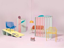 An arrangement of retro-style garden furniture and accessories in a pastel coloured studio