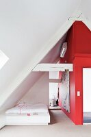 Bedroom with red wall in attic