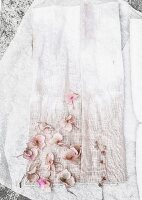 Subtly dyed fabric and pale pink hydrangea flowers