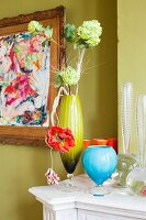 Arrangement of vases and flowers in retro interior