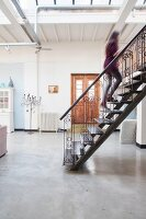 Steel stairs with hand-crafted balustrades and concrete floor in loft apartment