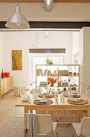 View over set dining table to partition shelving