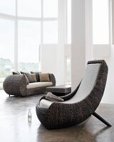 Modern wicker furniture in organic shapes in architect-designed house
