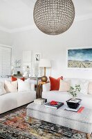Pale sofas and ottoman in lounge area