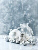 Arrangement of silver and white Christmas decorations