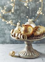 Vintage Christmas decorations on a cake stand