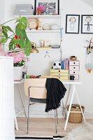 Ornaments on String shelves above white desk in girl's bedroom