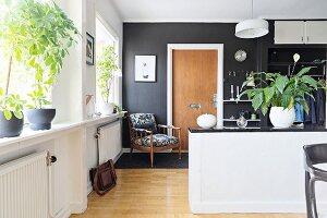 Retro armchair in open-plan living area
