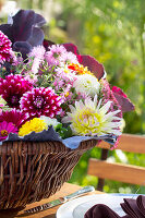 Autumn bouquet of cabbage leaves, hydrangeas, asters and dahlias