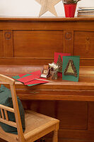 Christmas card with crocheted fir tree on front on piano lid