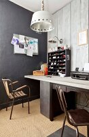 Black display case on desk against grey wood-clad wall