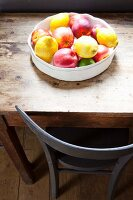 Bowl of fruit on rustic wooden table