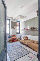 White wooden floor, bed and toys in child's bedroom