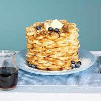 Waffles with butter, blueberries and maple syrup