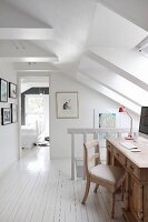 Wooden desk and chair in attic hallway