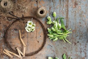 wreath made from rusty, flowers and parcel string on battered table