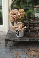 Dried hydrangeas in old zinc jug
