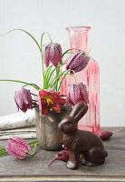 Snake's head fritillaries and chocolate Easter bunny
