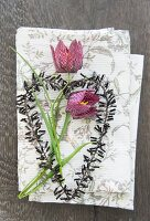 Snake's head fritillaries and black decorative heart on linen napkin