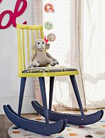 Old wooden chair converted into rocking chair in nursery