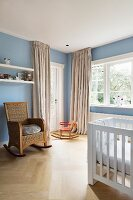 Rocking chair and rocking horse in pale blue nursery