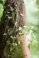 Girl with fairylike flowers twined in hair