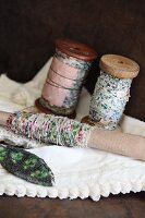 Vintage reels of beaded thread and beaded ornament