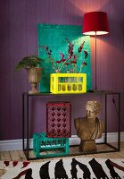Red flowers in yellow-painted milk crate, Roman bust and turquoise painting