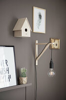 Pendant lamp with light bulb hung from wall bracket