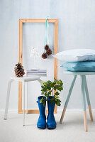 Stool, picture frame with Christmas decorations and Wellington boots