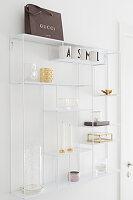 Ornaments on white, metal, open shelves