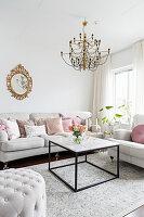 White sofa set and coffee table below window