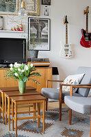 Nest of Scandinavian-style wooden tables in living room