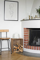 Firewood in old wooden crate next to fireplace with curved front