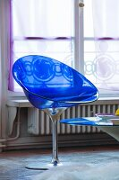 Transparent blue plastic shell chair