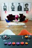 View from dining table into colourful living room with herringbone parquet floor