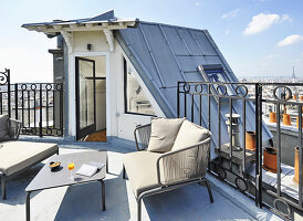 Seating area on roof terrace with view of Eiffel Tower