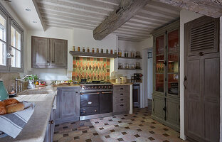 Country-house kitchen with wood-beamed ceiling