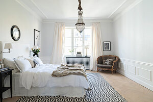 Wainscoting and stucco ceiling in elegant bedroom