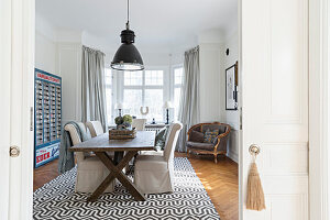 View through sliding doors into dining room with patterned rug